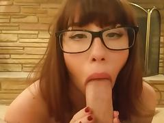 Redhead MILF with glasses BJ