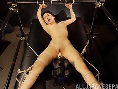 Sultry Asian amateur being teased with vibrators in a kinky bondage fetish clip