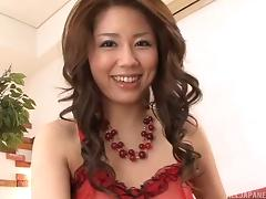 Tremendous Japanese MILF in red lingerie giving a hot handjob