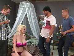Chunky blonde bimbo with massive tits gets fucked by three guys