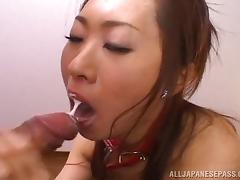 Attractive Asian woman sucking on three fat schlongs