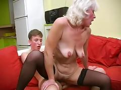 Good looking Russian granny enjoying a virile guy's rock hard cock
