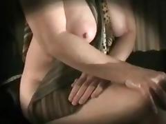 Breasty honey opens her legs, and shows vagina.