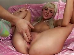 Gorgeous blonde with small tits has her anal stuffed with a dildo close up