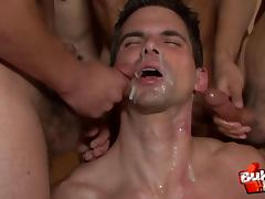 The gay gangbang ends with his face covered in hot cum