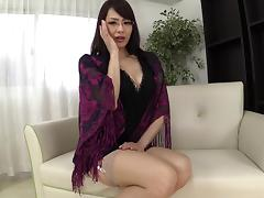 Horny Japanese MILF in stockings stimulating her aching lonely pussy