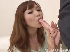 Rina Kato shows off her cock sucking technique on a dildo