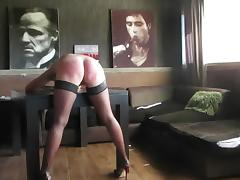 sub slut on table is getting a rough belt spanking!