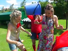 Colorful and playful bitches having a fun time outdoors