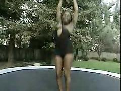 Trampoline fun with a chocolate Tgirl