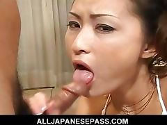 Japanese goddess in white on her knees sucking dick