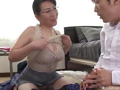 Smart Asian milf in a tight top blows him erotically