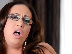 Busty mature with glasses toys her shaved twat