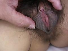 Asian MILF with a very hairy pussy get slammed from behind
