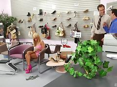 Shoe salesman has his way with a fake tits blonde