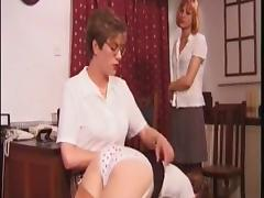 woman spanks two girls