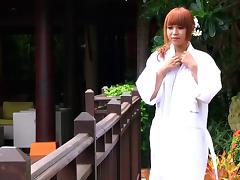 Elegant redheaded Japanese tranny stripping in the garden