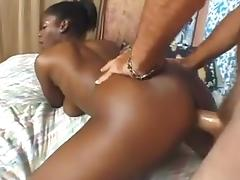 Big boobed black amateur fond of white dick