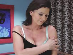 Granny and her gorgeous natural tits in a toy sex scene