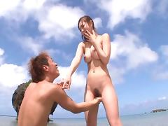 Fetching Japanese beauty rides the schlong on the tropic beach