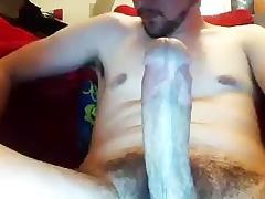Nice-looking poof is jerking off in his room and shooting himself on computer webcam