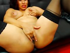 Horny latina with milky dribbling tits fingers her pussy