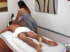 Curvy Asian masseuse rubs him down and rides his big dick