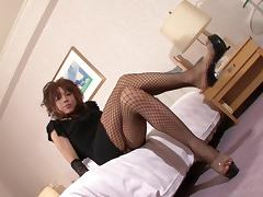 Hottest Asian shemale in stockings plays with his own stiff pecker