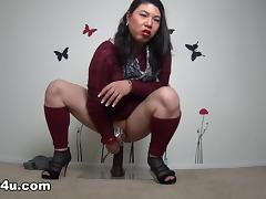 Japanese tranny milf sits on a big black dildo and rides