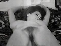 striptease on bed - circa 50s