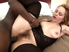 Hot wet bush of a naughty while milf fucked by black dick