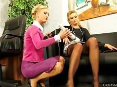They fire up a beautiful lesbian sex action using vibrators in the office