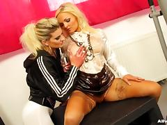 Sensual long haired blonde oils her lesbian mate's pussy and ass in a reality shoot