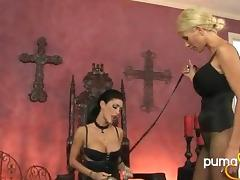 Dominant chicks play with a submissive lezzy in the dungeon
