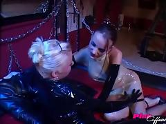 Rubber and latex lesbians have a wild strapon fuck in the dungeon