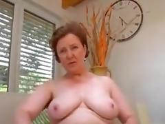 Mature removes knickers and plays
