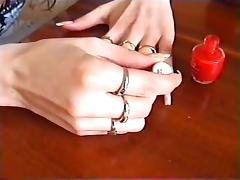 Long natural nails red polishing