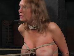 Poor senorita is tied up to a cross and has to handle a BDSM torture