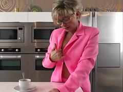 Dazzling matured granny drilling her juicy pussy using toy in the kitchen