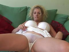Wonderful matured blonde unpinning her panties before masturbating