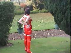 Sexy legs outdoors in full RED PVC top mini and thigh boots