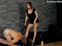 Leashed sub does whatever his gorgeous mistress commands