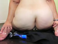 bbw hairy milf  stuffs a glass dildo her butthole