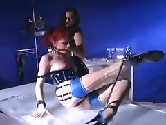 Mistress in latex and her girl slave