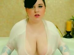 Horny plumper rubs her huge tits in the bath