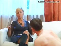 High heels dick into his chest as the mistress tramples her man