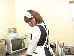 Hot maid masturbates in the kitchen with a toy