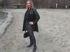 Leather slut with buttplug outside