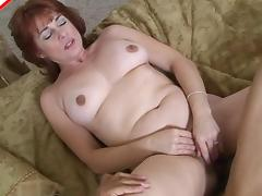 Foxy redhead MILF Calliste has her shaved cunt plugged hard