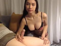 Brunette with big tits gives a handjob